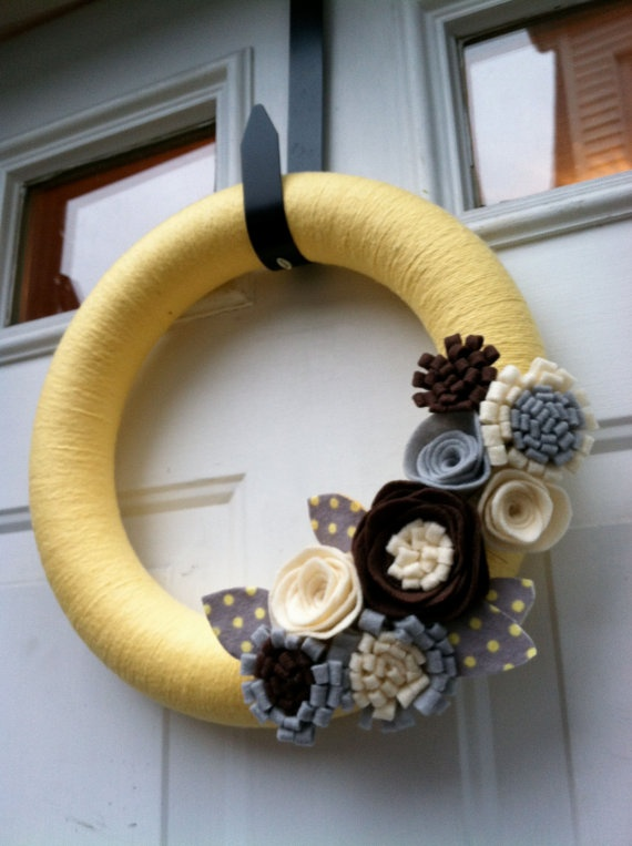 Found on etsy and so pretty! Yellow Yarn Wreath with Felt Flowers Great for by stringnthings.