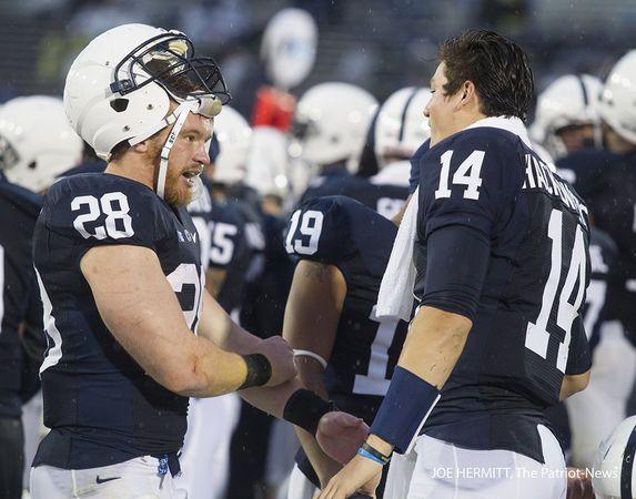 Penn State running back Zach Zwinak and quarterback Christian Hackenberg talk during the fourth quarter at Beaver Stadium. Penn State beat Kent State, 34-0.