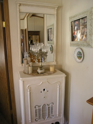 Lovely reuse of an antique radio cabinet!  Vintiquities Home