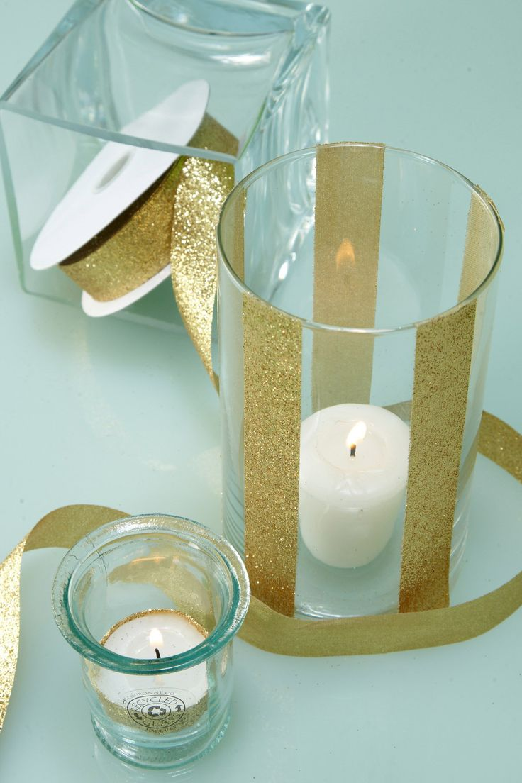 """Glitter Ribbon Gold 7/8in x 25yds This brilliant Gold Ribbon is covered with glitter and makes an excellent accessory to use on gifts or displays at your wedding or event. For a striking decoration, attached double-sided tape to the back and secure the ribbon around vases or candle holders (as shown). 25 yards of 7/8"""" wide unwired gold glitter ribbon 55% metallic, 45% nylon $5.99"""