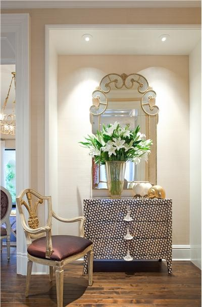 Elegant Contemporary Hallway by Jamie Herzlinger.  master bedroom entry...chest and mirror