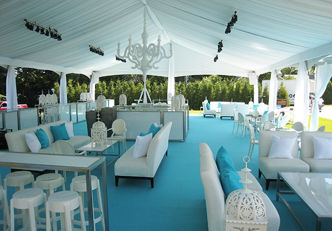 Cottage reception, utilizing blue as focus, vases filled with blue water, menu predominantly seafood