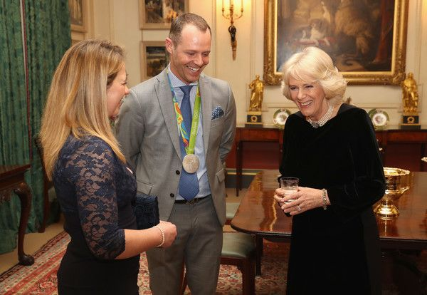 Camilla, Duchess of Cornwall (R) with equestrians Kitty King (L) and Spencer Wilton during a reception for the British Equestrian teams who took part in the 2016 Olympic and Paralympic games at Clarence House on January 24, 2017 in London, England. - The Duchess of Cornwall Hosts a Reception for the British Equestrian Teams for the 2016 Olympic & Paralympic Games