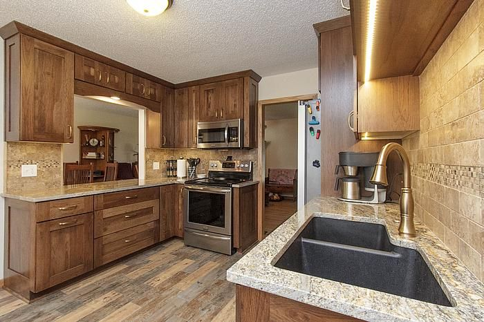 Designers: Laura (cabinets) and Bill (flooring) Cabinets: Dura Supreme Cabinetry Napa Panel Plus Hickory door in Mocha finish Backsplash: Noce Trav? Pinteres?