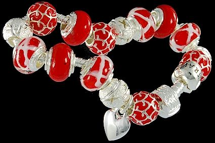 silver plated items: bracelet with snap closure, enamel beads, balls, heart charm, lock. Seven glass beads with 925 silver core.