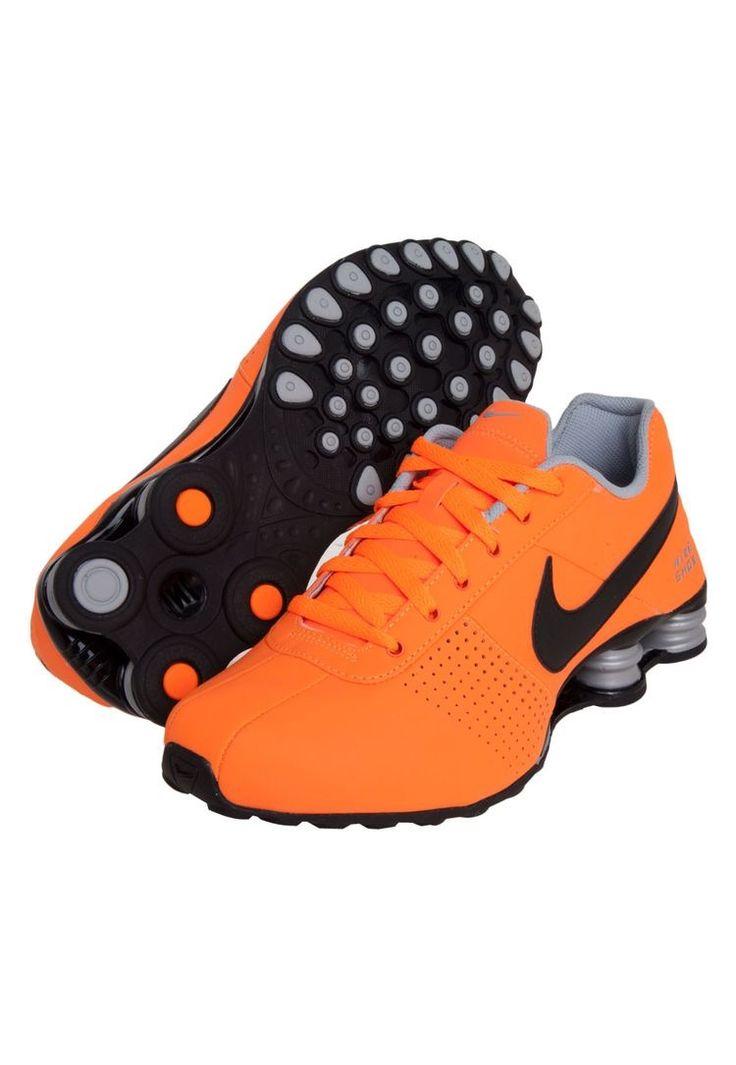 Orange/black Nike Shox