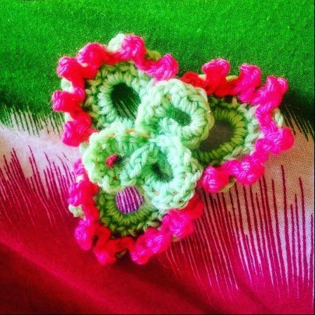 How to Crochet Flower in 3D ~ Free Crochet Pattern  This crochet flower is created to be in 3D. It can be used as a single motif or you can combine several together.      Crochet Materials  Crochet hook size 4.0    Crochet yarn 4 ply in green and pink.    Crochet