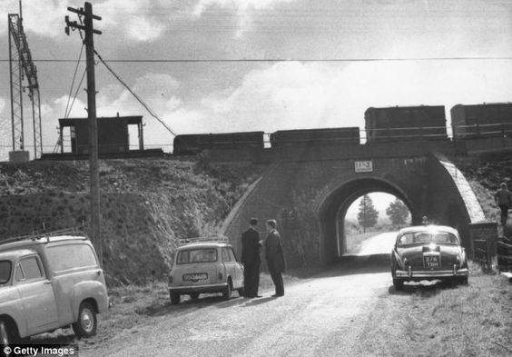 1963 Great Train Robbery in UK went unsolved until August of 2013, 50 yrs after the crime, Scotland Yard Detectives are credited-Scene nr. Cheddington