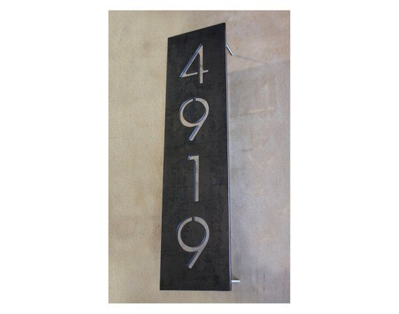 This is what I want for my house numbers. So cool and would totally pick-up the oil-rubbed bronze from the door. The Congress House Numbers by boldmfg on Etsy, $135.00