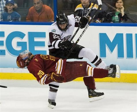 Union College's Mat Bodie (22) levels Ferris State's Matthew Kirzinger (20) with his elbow during the third period of the NCAA Frozen Four semi-finals in Tampa, Florida, April 5, 2012. Ferris State defeated Union College 3-1 to advance to the championship game.