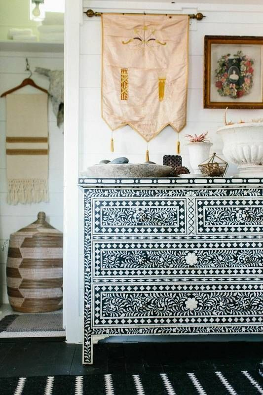 8 ways to fake a well-traveled home. Think globally to mix and match cultural influences, hang an eclectic gallery wall, use textiles and animal prints and start building your own collection!