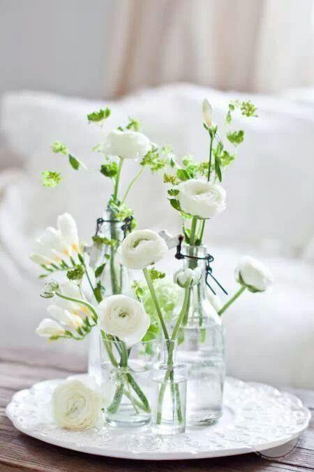 White ranunculus and freesias