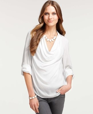 Cowl neckline flatters most. Rolled up sleeves draws attention away from hips. Longer hemline better for longer legs. Casual and Romantic personal style.