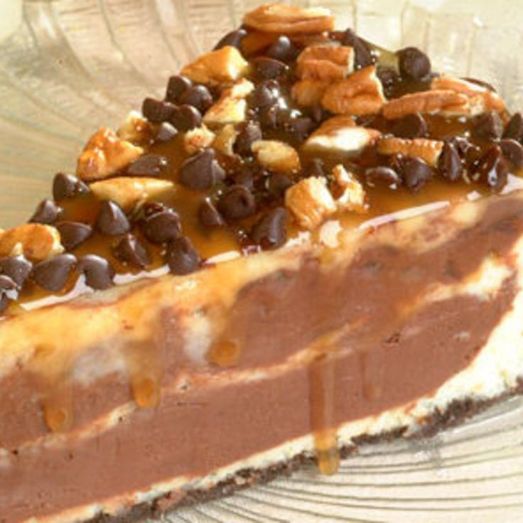 "A finalist in the Nestlé Toll House ""Share the Very Best"" recipe contest, this Turtle Cheesecake dessert was submitted by Audra Burtch of Chandler, Arizona. This family favorite is a marbled cheesecake topped with a decadent combination of pecans, chocolate morsels and caramel and chocolate syrups."