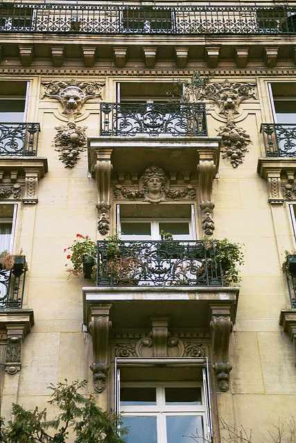 I could easily live in one if these quaint little condos with the brilliant balconies! I'm in love already!
