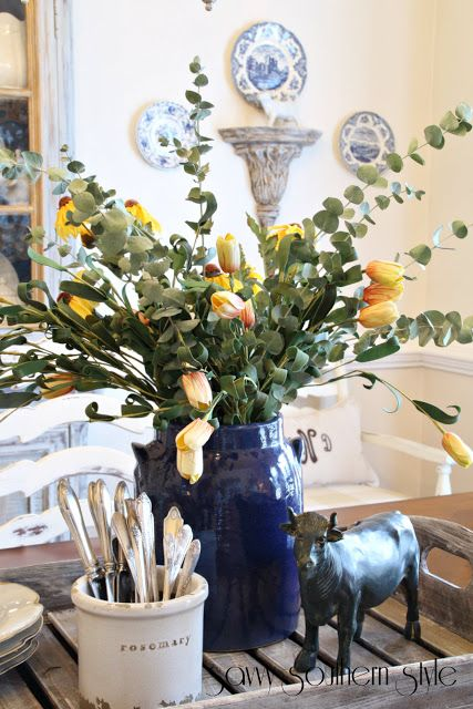 Savvy Southern Style: French Farmhouse Style Vignettes love the bull! And the yellow tulips look AWESOME with eucalyptus !!!