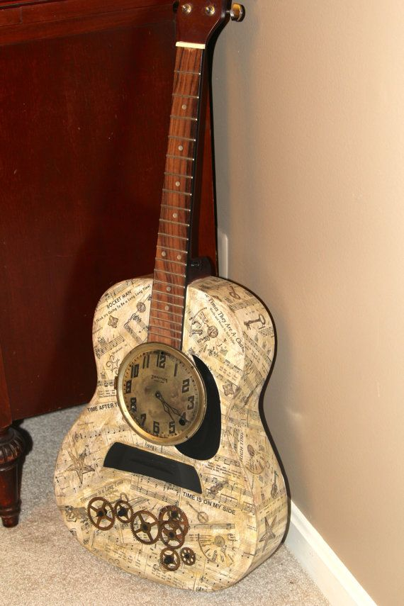 "Inspired by music lyrics of ""time"", it repurposes a damaged guitar, sheet music, and antique clock parts for this mixed media truly unique art piece."