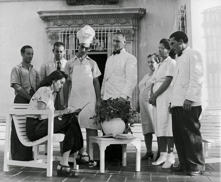 Subject: Socialite (debutante) Aline Johnson de Menocal meeting with her personal staff to plan a party. Havana, Cuba 1946. Photographer: Nina Leen/Time Inc ...