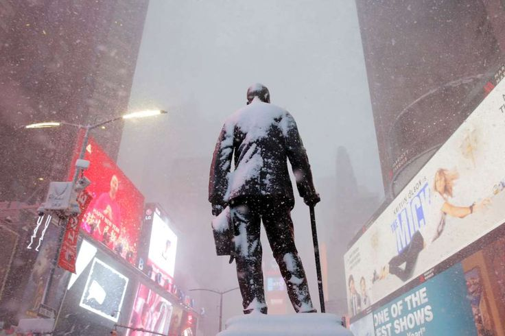 A statue of American composer, playwright, actor, and producer George M. Cohan stands in Times Square as snow falls in Manhattan  -   A statue of American composer, playwright, actor, and producer George M. Cohan stands in Times Square as snow falls in Manhattan, New York City  -  February 9, 2017