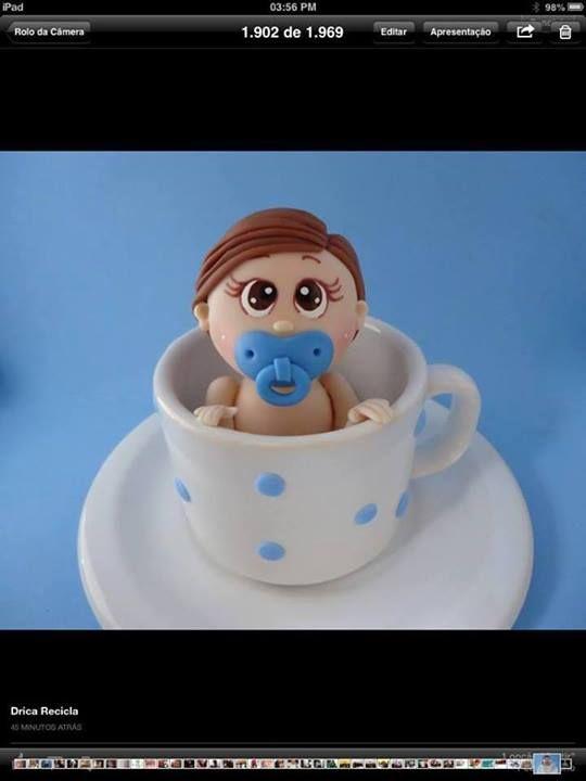 Baby in coffee mug