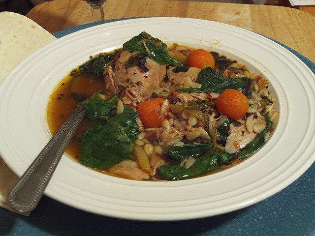 Chicken and spinach millet soup with carrots