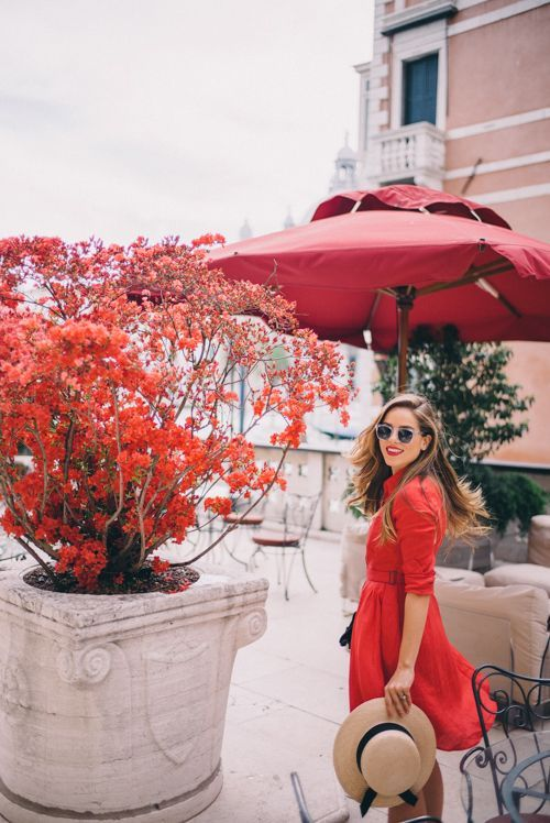 red tree in pot, cute red dress, straw hat