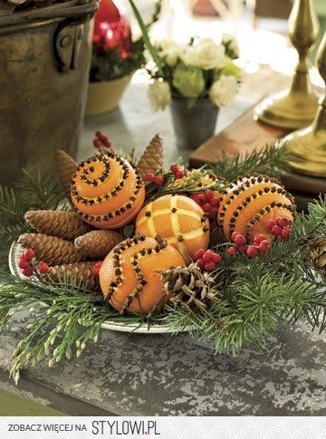 Rustic Centerpiece with cloved oranges and pine cones and greenery