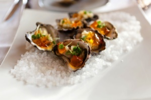 """Try the Coffin Bay oysters. Order some abalone that was caught just hours before it hits your plate. Sip some Shiraz while you watch the dolphins and whales play. Can you name the """"Seafood Frontier"""" of Australia?"""