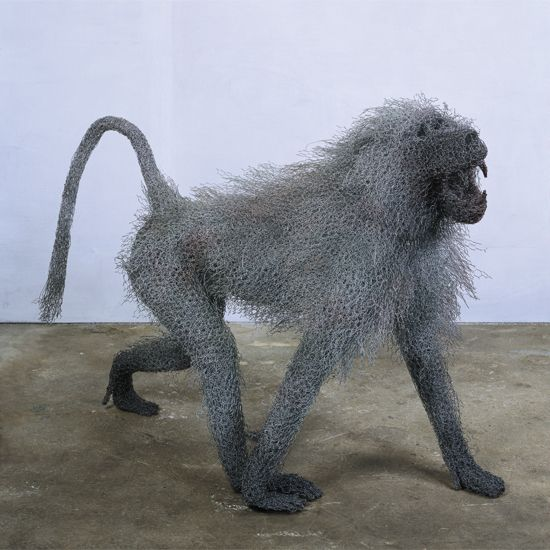wire mesh sculptures by Kendra Haste. shown is  Alpha Male Baboon (2003)