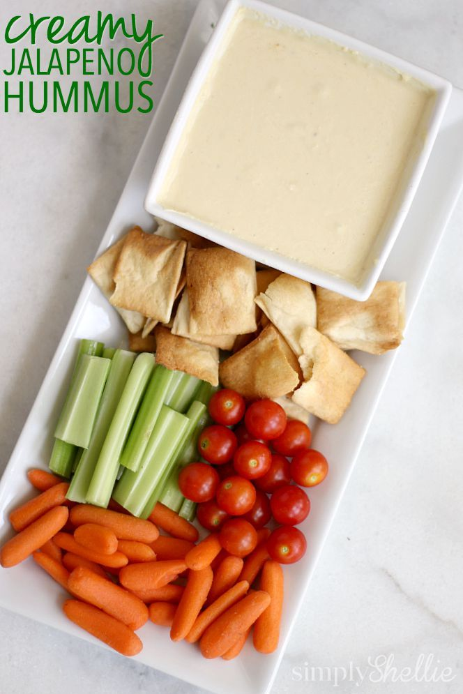 We love this Creamy Jalapeno Hummus dip! It's creamy with a nice little kick! Perfect game day dip or for that late summer potluck. There is a secret ingredient which is the key to the creaminess!