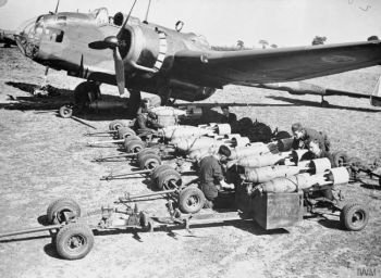 A Hampden Mk 1 of 49 Squadron being 'bombed up' at Scampton, June 1940. On 12-13 August, aircraft of 49 and 83 Squadrons successfully blocked the Dortmund-Ems Canal, which halted the flow of invasion barges from the Rhineland to the coast for 10 days. For his part in the operation, Flight Lieutenant R A B Learoyd of 49 Squadron was awarded the Victoria Cross. CH 254.