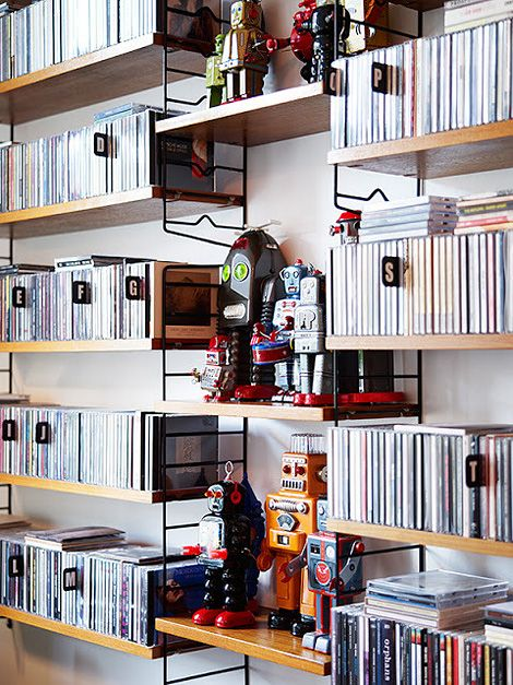 String shelving with robots and an alphabetized CD collection. What's not to love? Via iainclaridge.co.uk