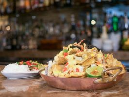 """Brennan's of Houston: Houston : <p>The humble nachos get a high-end makeover at the iconic <a adhocenable=""""false"""" title=""""Brennan's of Houston"""" href=""""/content/food/restaurants/tx/houston/b/brennans-of-houston-restaurant.html"""">Brennan's of Houston</a>. Executive Chef Danny Trace channels his """"Texas Creole"""" style into this luxe recipe. The Blue Crab and Caviar Nachos feature fire-roasted corn, St. Andre queso, alligator pear (aka avocado), mirliton pico de gallo, lime crema, and, of course…"""