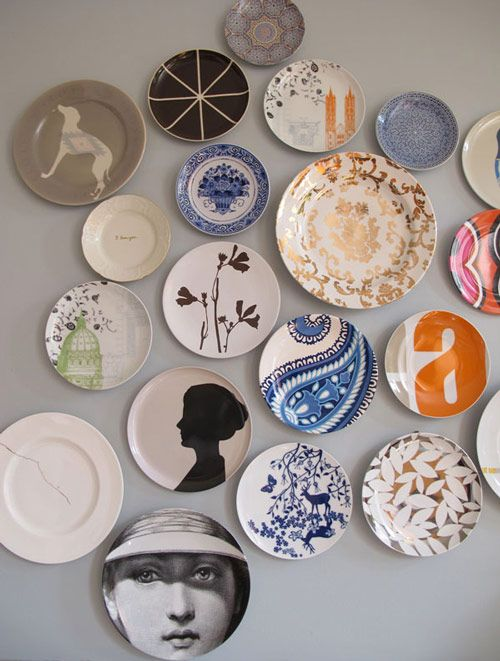 Yet another beautiful plate collection, this time displayed above the fireplace mantel