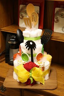 Wedding shower cake! Love this idea. Make it with dish towels spices and other random kitchen items.