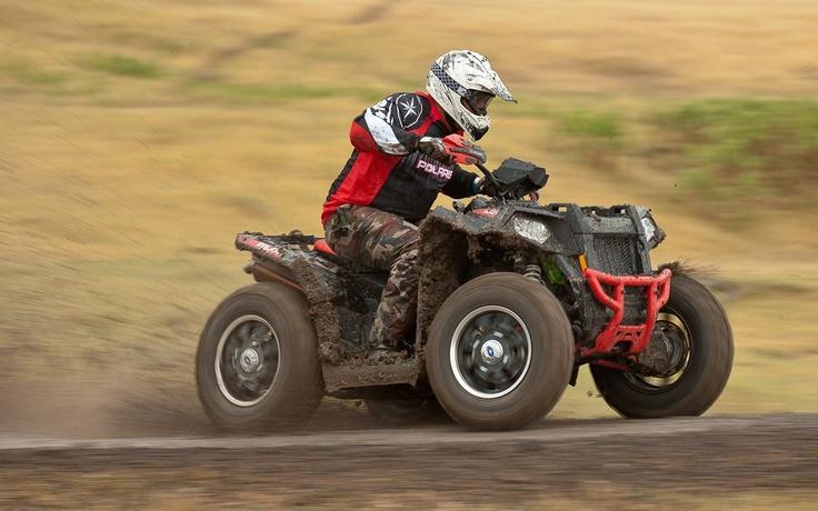 """The Fox shocks on this Stealth Black LE version set all that Scrambler power free - Photo Gallery - ATV Trail Rider"""