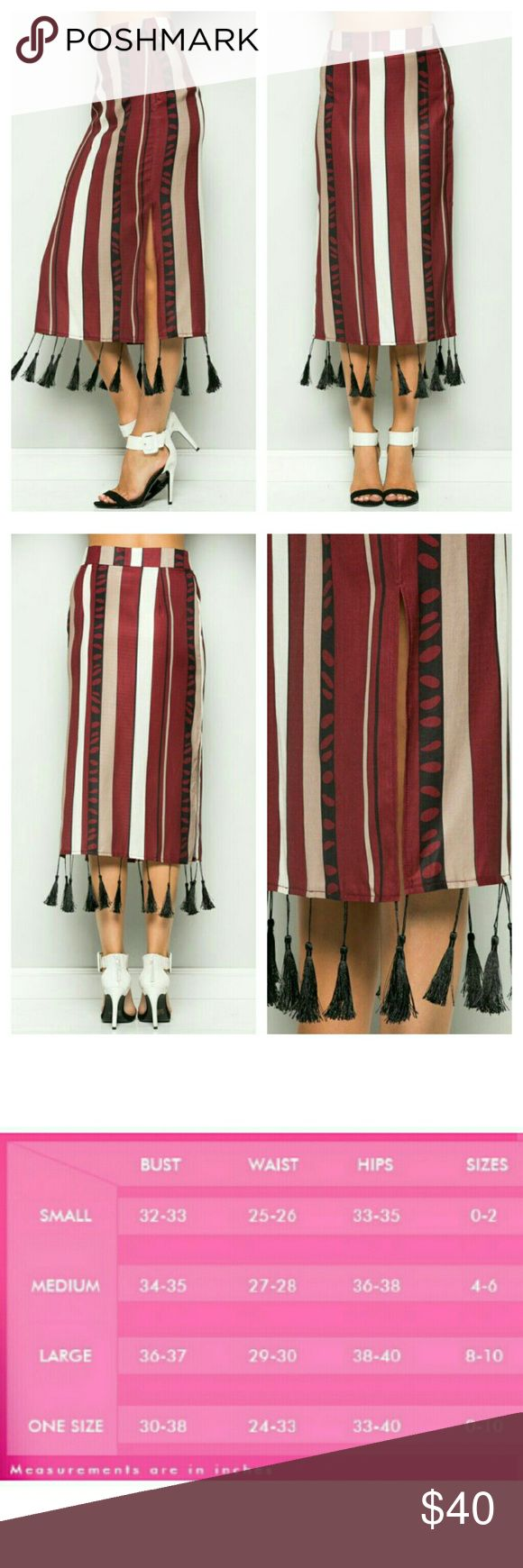TASSEL BOTTOM STRIPE SKIRT Absolutely one-of-a-kind, this TASSEL BOTTOM STRIPE SKIRT looks like one your granny owned. Featuring burgundy/white/ black stripes, a sexy Midi-Length, a modest side split, and a zippered side. This skirt is lovingly  made out of 100% polyester and is a relaxed fit. FabFormula  Skirts Midi