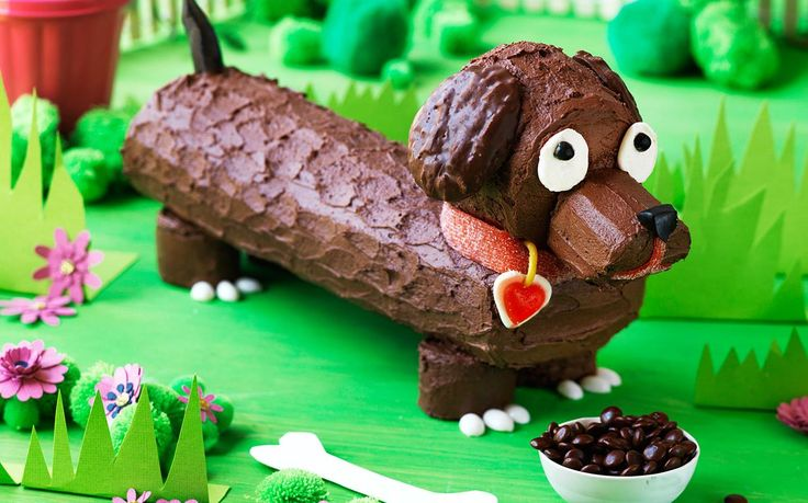 Frankfurt the sausage dog cake recipe - By Australian Women's Weekly, Calling all little dog lovers! Frankfurt, the sausage dog is a delicious and easy chocolate covered sponge roll. Don't forget to add his bowl of M & M's dog food!
