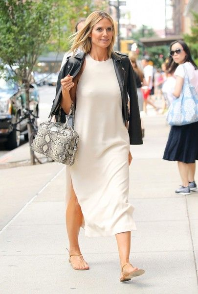 Model Heidi Klum is seen at her hotel in New York City, New York on July 19, 2016. She draped a black leather jacket over her scoop-neck…