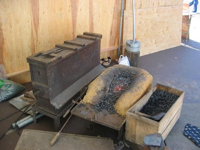 Traditional Japanese forge and box bellows called fuigo.
