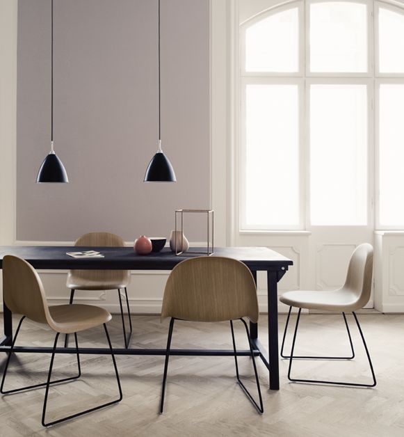 Black table, wooden chairs.