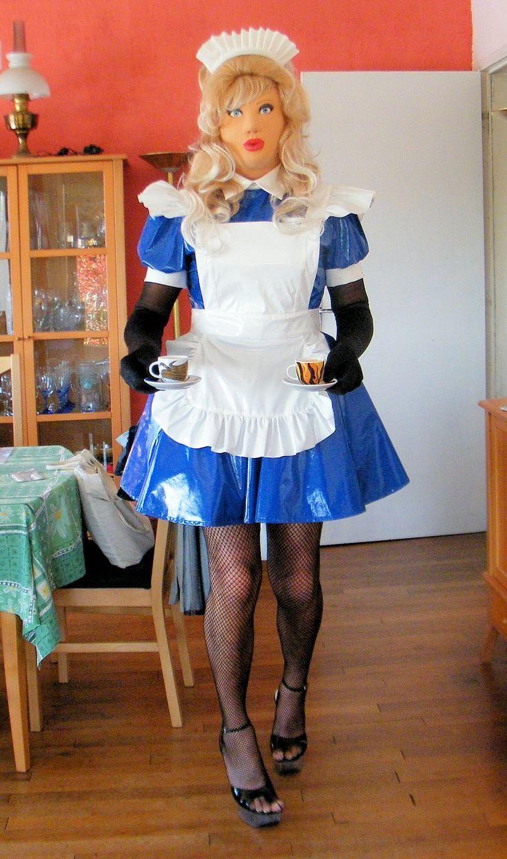Transvestite TV maid serving coffee to Mistress.