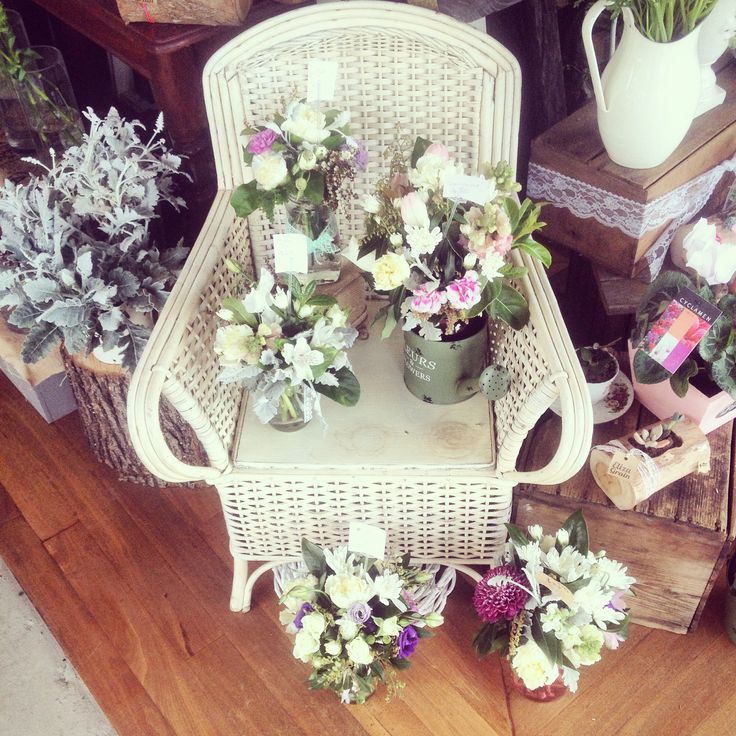 Mixed posy jars on an old school chair
