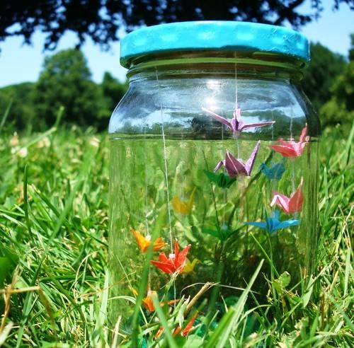 So sweet!  Tiny origami cranes in a jar would make a great display piece, or table decoration.