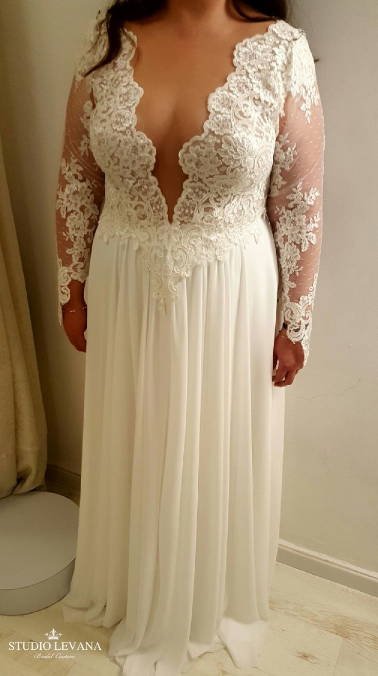 Plus size wedding dress with long sleeves and deep V cleavage on a real plus siz…