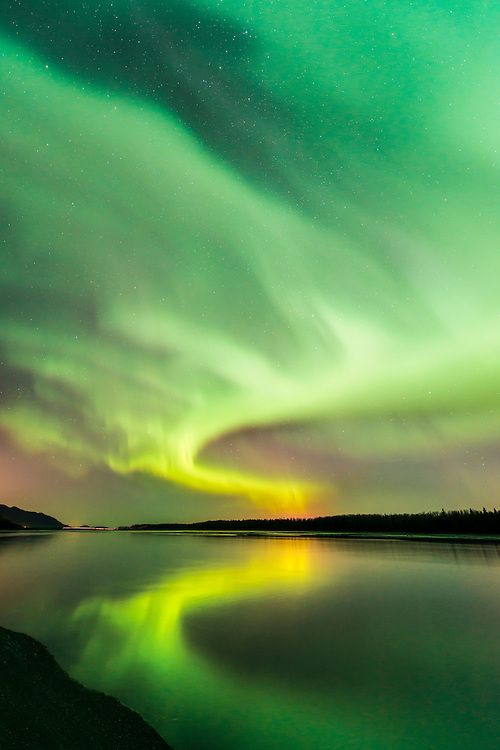Autumn aurora borealis over the Knik River at Jim Creek near Palmer, Alaska.