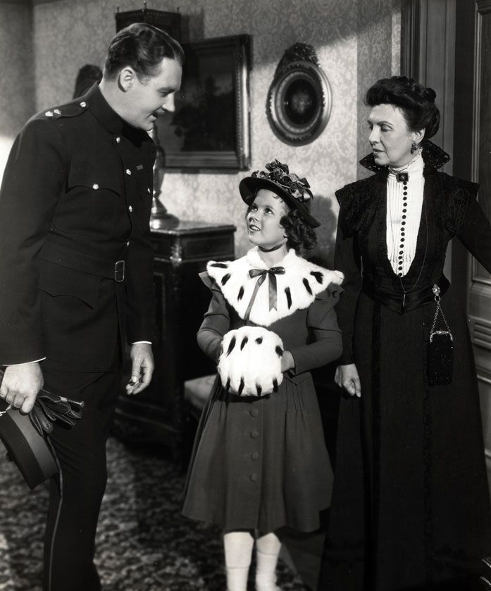 Shirley Temple with Ian Hunter and Mary Nash in The Little Princess, 1939.