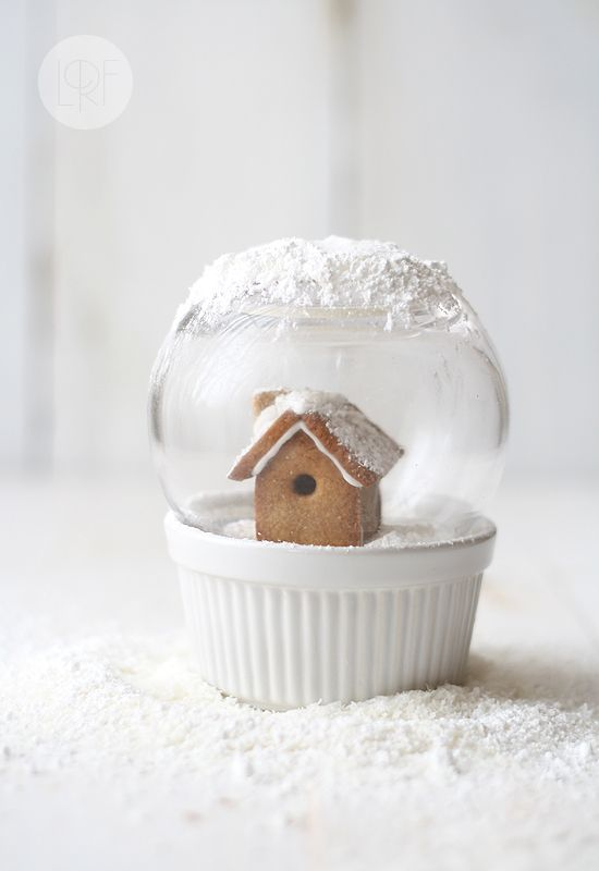 Edible Snow Globe:  Gingerbread house sits in a ramekin atop a dessert (pudding) that is covered with whipped cream or coconut for snow effect.  The glass is an upside-down bubble-shaped glass. {neat idea - can interchange everything}