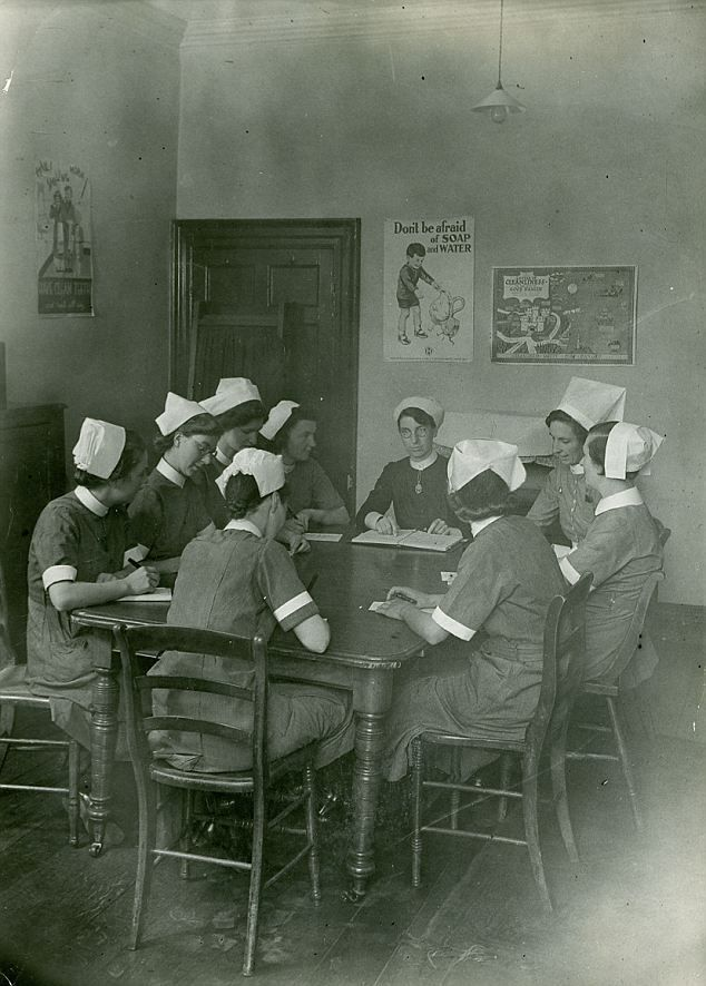 Thirties nurses take instructions from their superintendent