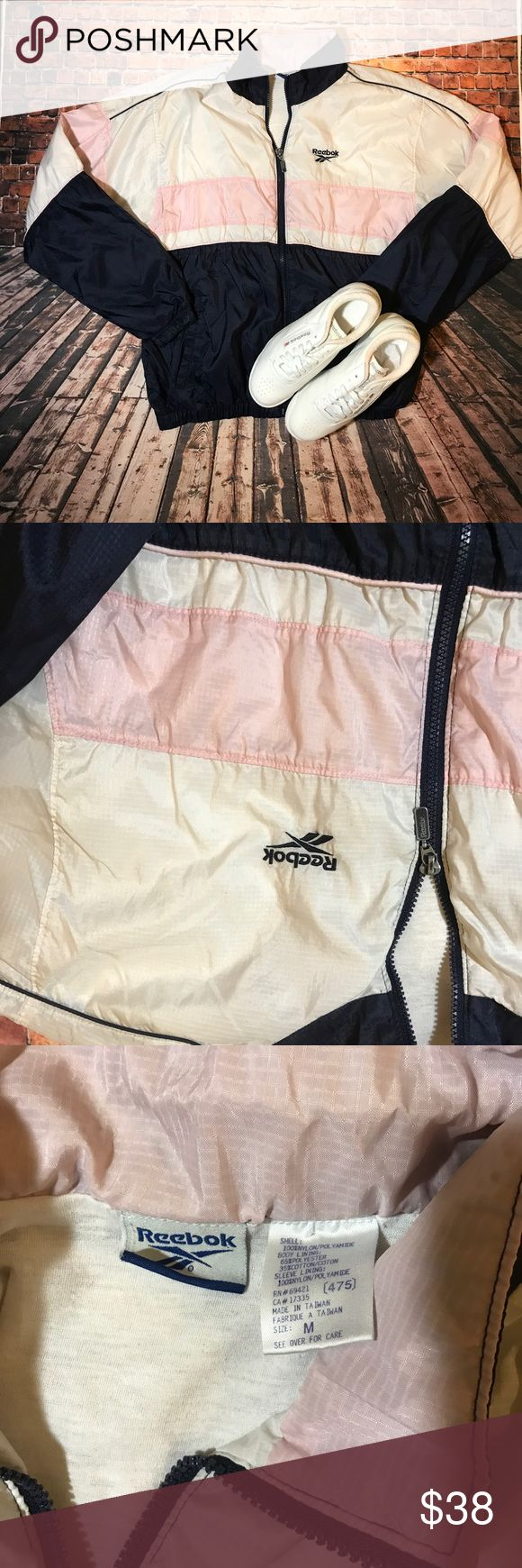 """Vintage colorblocked ladies reebok windbreaker If u are into those trendy 90's streetwear looks this has ur name all over it .... this piece is lined , as it's also a full zip , and 2 hand pockets .... the colour way is of navy blue / pink and white , also has the Embroidered reebok font on chest , and as well as on back but bigger .... excellent condition 9/10 .... perfect for fall with a pair of mom jeans , and some princess classics on yer feet ...chest 19"""", and length is 25"""" ...PRICE IS…"""
